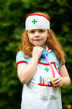 6 Year Old Girl Role Playing As A Nurse