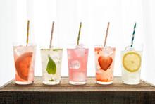 Five Varieties Of Lemonade With Colored Straws