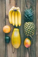 Tropical Fruit Arrangement On Wood Background