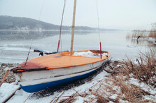 Small Boat At The Frozen Lake Wallersee Landscape In Austria In Winter