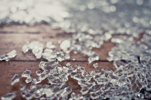 Sheets Of Shattered Glass On A Wooden Floor
