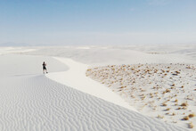 Man Taking Pictures From White Sand Dune