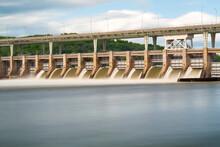Muddy Water Rushing Through Spillway Gates Of Chickamauga Dam On TEnnessee River