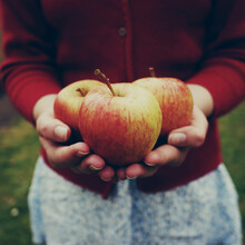 Holding Apples