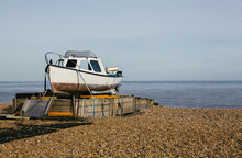 Fishing Boat On An Empty Beach, Kent, UK.