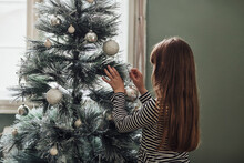 Girl Decorating The Christmas ...