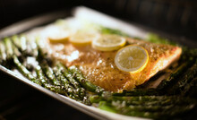 Roasted Salmon And Asparagus On Parchment Paper In The Oven