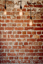 Brick Wall With 3 Hanging Pend...