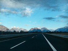Empty Highway With Mountains O...