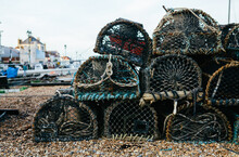 A Stack Of Lobster Pots On The Beach Ready To Be Loaded Onto A Fishing Boat.