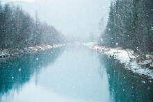 Snow Falling On A River