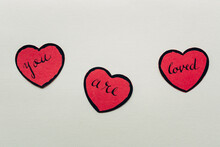 """You Are Loved"""""""" Written On Red Paper Hearts"""