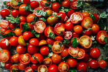 Tomatoes And Herbs In Olive Oil