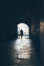 Woman Walking On Old Street In...