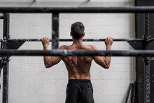 Man Doing Pull-ups In A Gym. V...