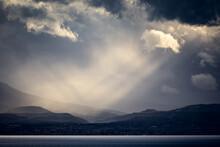 Sun Rays Through Turbulent Sky