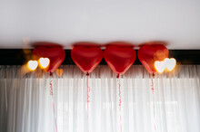 Custom Bokeh Hearts Exposed On 4 Red Balloons