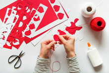 Woman Making Diy Red Hearts Decoration