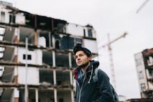 Young Man Walking In A Demolished Quarter