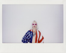 Young Blond Woman With USA Flag