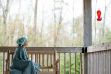 Girl Cottage Porch Observes Na...