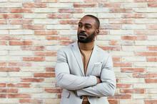 Confident Black Man Near Brick...