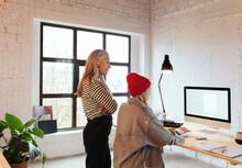 Senior Designer Supervising Young Colleague