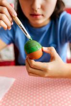 Little Girl Decorating Easter Eggs