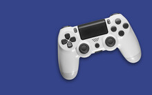White Game Controller On Blue Background