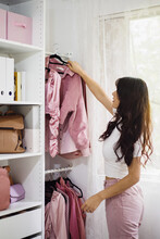 Woman Choosing Clothes In Her ...