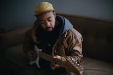 Portrait Of Man Playing Music ...