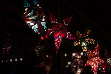 Hanging Star Lanterns Reflecting In The Glass