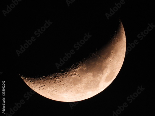 Obraz na plátně Moon background / The Moon as it appears early in its first quarter or late in its last quarter, when only a small arc-shaped section of the visible portion is illuminated by the Sun