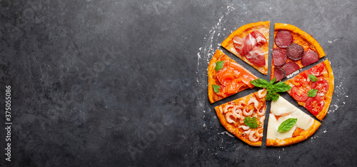 Fotografering Tasty slices of different pizza