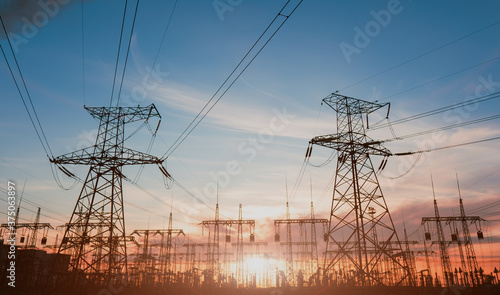 Fotografie, Obraz High-voltage power lines at sunset or sunrise