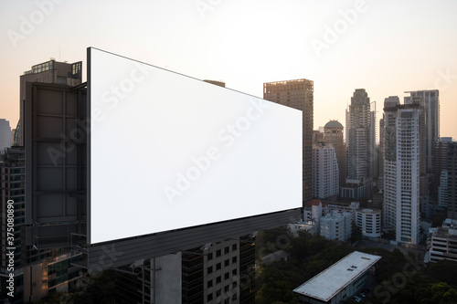 Blank white road billboard with Bangkok cityscape background at sunset Canvas Print