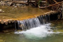 Small Waterfall On Wooden Boar...