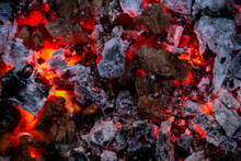 Burning Coals. Close-up Of Decaying Charcoal, Barbeque Season. Bright Flashes Of Fiery Flames. Burning Hot Coals And Wood In The Night. Red Coals Burned In The Bonfire.