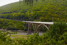 The Mountain River Along The Road, Of A Scenic Highway By The Beautiful Landscape Covered In Clouds And Fog, Bridge And Viaduct, The Mountain River Along The Road,