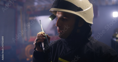 Fotografie, Obraz Firemen answering emergency call on station
