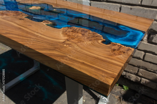 Obraz beautiful wooden table made of elm slab and epoxy resin - fototapety do salonu