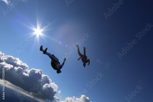 Skydivers over snowy mountains in Norway Fotobehang