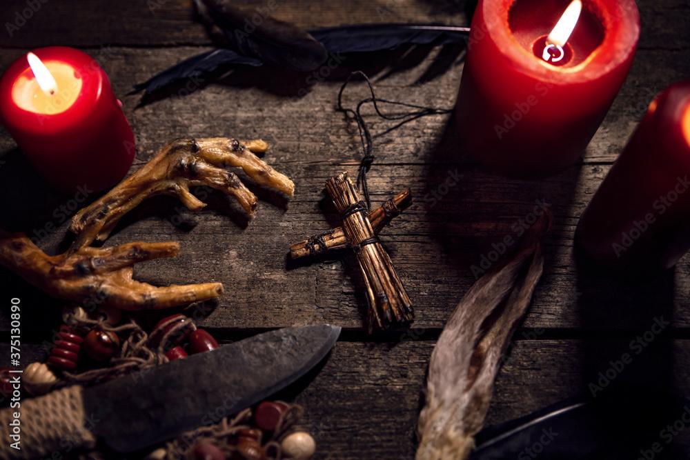 Fototapeta Dark Voodoo or vodun ritual with puppet, crow´s feet and knife