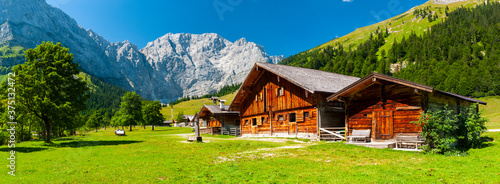 Fotografering panorama landscape in alpine mountains with farmhouse