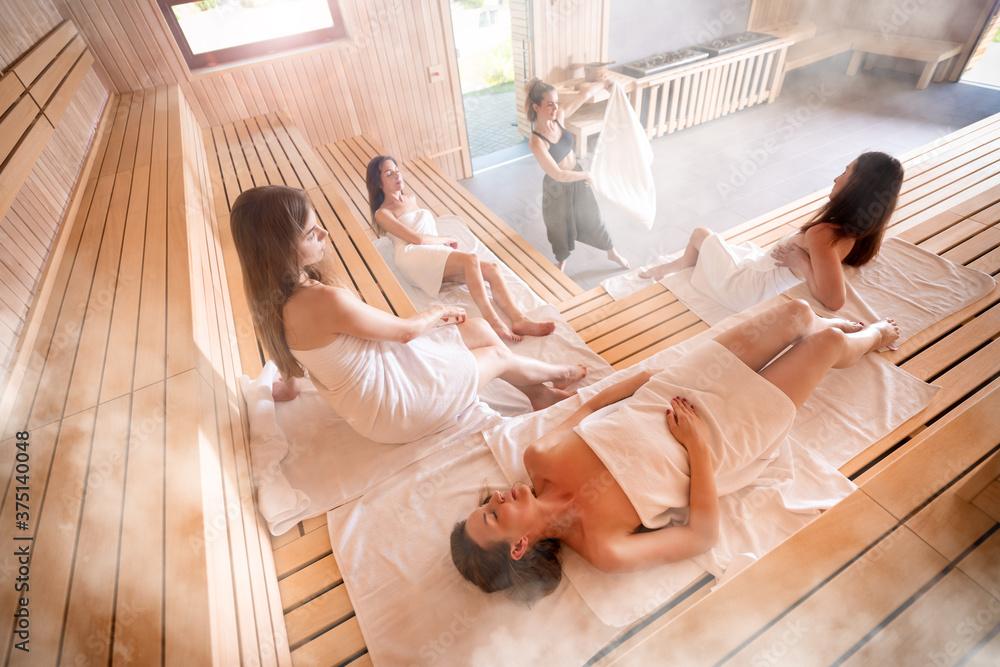 Fototapeta Sauna master making ritual in Finnish sauna