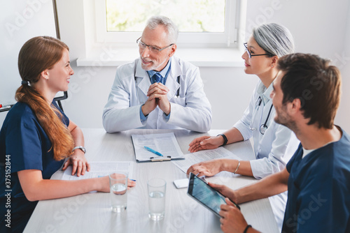 Fotografie, Tablou Healthcare professionals team having discussion in hospital meeting room