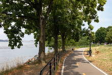 Astoria Queens Riverfront Trail At A Park Along The East River In New York City During Summer