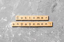 Customer Engagement Word Written On Wood Block. Customer Engagement Text On Cement Table For Your Desing, Concept