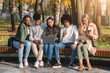 canvas print picture - Addicted teenagers using gadgets while spending time in park
