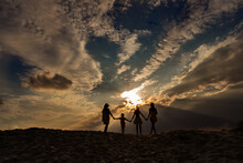 Sunset And Family On The Sand,...